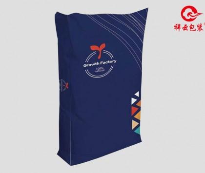 规格: 55*97cm(40kg) 塑编珠光膜 蓝三角
